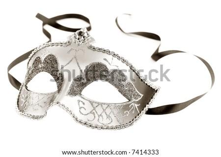 Sepia toned carnival mask on white background