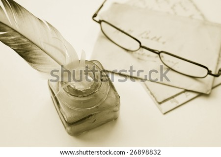 Sepia toned image of an ink pot with feathered quill and hand written letters (recreated by self) and a pair of reading glasses.
