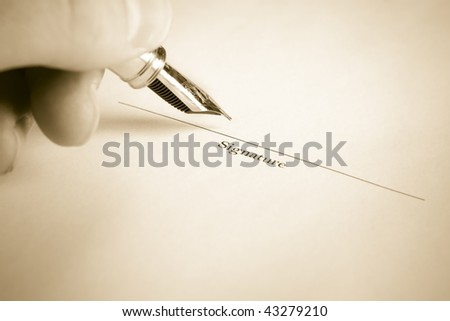 Sepia Toned image of Left Hand Signing Name with Fountain Pen