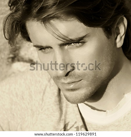 sepia toned portrait of handsome man