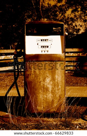 Sepia Toned Rusty Old Petrol Bowser At A Old Abandoned Outback Petrol Station - stock photo