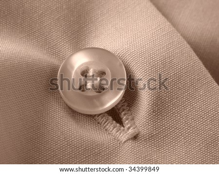 sepia toned shirt fragment with button closeup