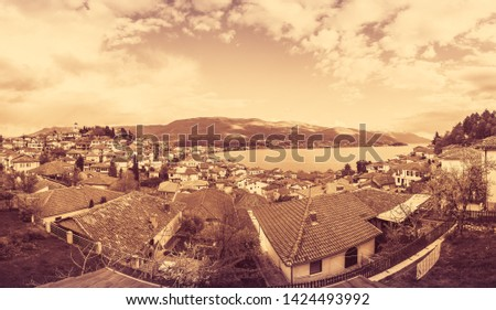 Sepia vintage retro image of the of hillside red tiled rooftop houses on the shore of Lake Ohrid, Northern Macedonia