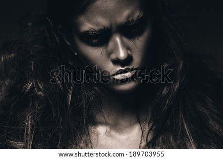 sepia woman with black make up and fluffy hair