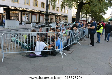 SEPTEMBER 18, 2014 - BERLIN: fans of Apple products waiting in line for the new IPhone6 one day before the sale of the new telephone starts, Apple Store, Berlin.