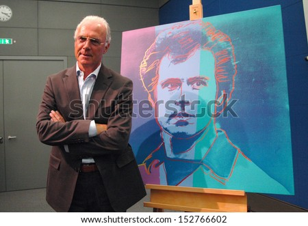 SEPTEMBER 1, 2005 - BERLIN: German soccer legend Franz Beckenbauer next to his portrait painting (by Andy Warhol) - presentation of the cultural program to the soccer world championship, Berlin.