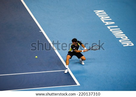 SEPTEMBER 25, 2014 - KUALA LUMPUR, MALAYSIA: Pablo Andujar of Spain makes a backhand return in his match at the Malaysian Open Tennis 2014. This is an ATP sanctioned tournament. #220137310