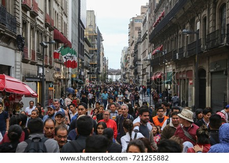 September 3, 2017 - Mexico City, Mexico: Pedestrians walk down the busy streets of the historical center of Mexico City.