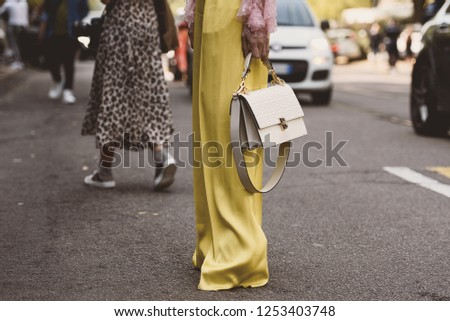 September 20, 2018: Milan, Italy -  Street style outfit during Milan Fashion Week - Fendi bag - MFWSS19 #1253403748