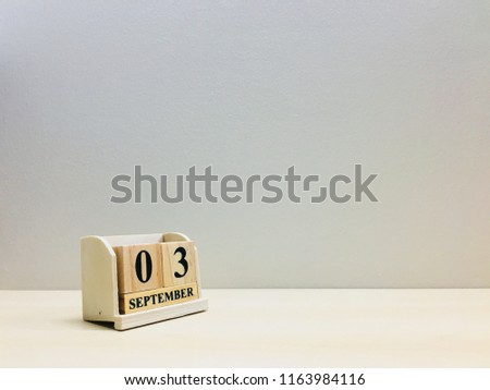 September 3rd,Image of number 3 wooden on grey and light brown color background with space for your text and design.Concept be used for birthday,appointment and deadline.Blur picture and vintage style