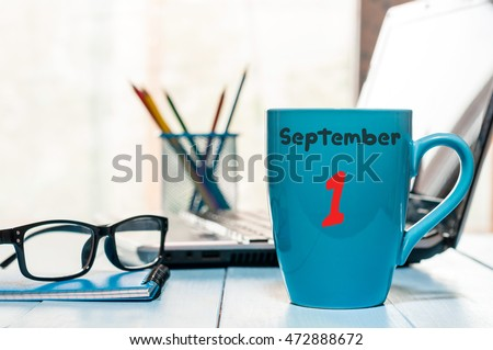 September 1st. Day 1 of month, Back to school concept. Calendar on cup morning coffee or tea teacher, student workplace background