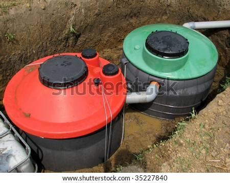 Septic system instalation in rural area - stock photo