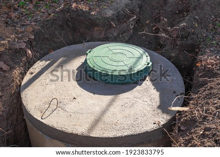 Septic tank made of concrete rings with a hatch for a private country house. Wastewater and sewerage drainage. Stock photo ©