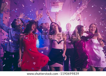 Sequins fall from violet ceiling, ecstatic, positivity, happiness, emotion, excited, rejoice persons dance make big toothy smile, raised hands up