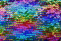 Sequins macro background.Multicolored sequins.Rainbow. Scales background. Paillette fabric background.sparkling sequined textile