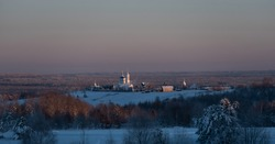 Seraphim women's monastery in the village of Yb, Komi Republic, Russia, on a frosty winter day in a time of sunset.