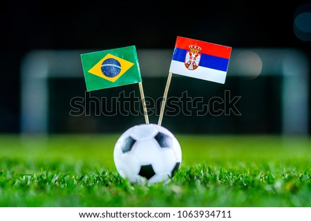 Serbia - Brazil, Group E, Wednesday, 27. June, Football,  National Flags on green grass, white football ball on ground. #1063934711