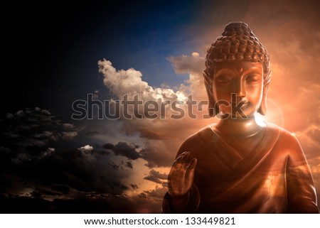 Serene Buddha statue on stormy and cloudy background