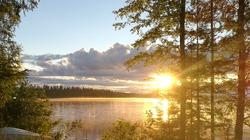 Serene Lake at Sunset or Sunrise, Sun Reflecting in the Water