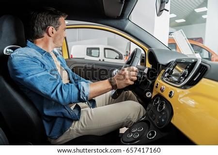 Serene man driving new vehicle #657417160