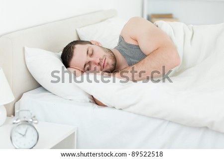 Serene man sleeping in his bedroom