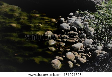 Serene riverbank with smooth stones #1510713254