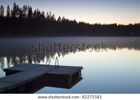 Serene scene with jetty photographed at twilight