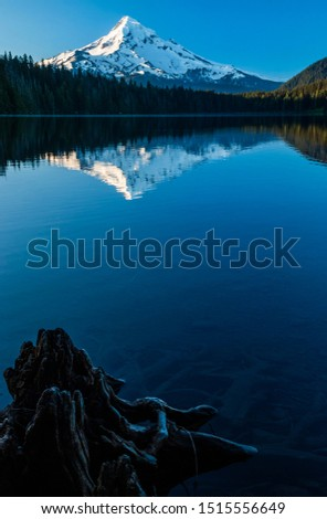 Serene scene with the reflection of Mount hood in calm waters of Lost Lake in Oregon, USA #1515556649