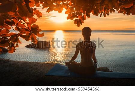 serenity and yoga practicing at sunset,meditation