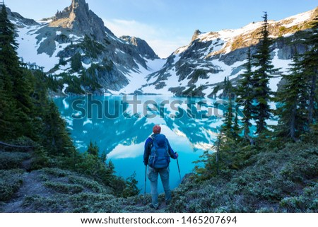 Serenity lake in the mountains in summer season. Beautiful natural landscapes. #1465207694