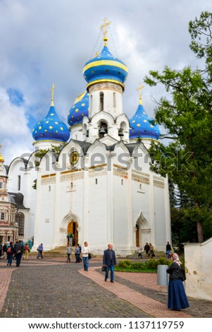 Sergiyev Posad, Russia - August 30, 2012:  Pilgrims and tourists at  Church of the Descent of the Holy Spirit at Holy Trinity St. Sergius Lavra. Unidentified people present on picture.