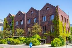 Serial houses made of red bricks seen in Berlin, Germany