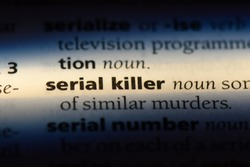 serial killer word in a dictionary. serial killer concept.