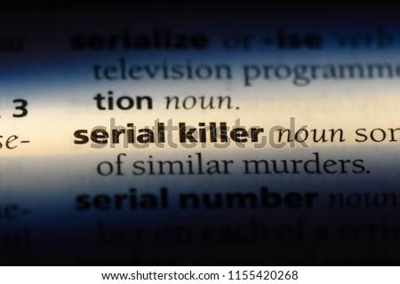 serial killer word in a dictionary. serial killer concept.