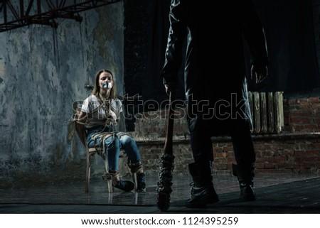 Serial maniac prepares to kill his female victim