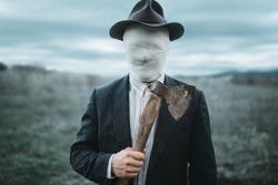 Serial murderer with axe in hands, crazy monster