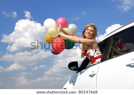 series close-up portrait of a girl in the car with colorful balloons