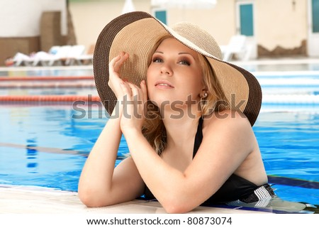 series closeup portrait the smart blonde in a hat in pool of expensive hotel