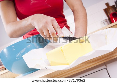 Series of a woman cooking in the kitchen with bright bowls, cutting butter