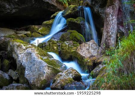 Series of beautiful views on Myra Falls waterfalls with mossy stones in Lower Austria (Myrafälle Wasserfälle, Niederösterreich), Austria.