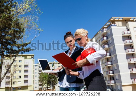 Series of images and video featuring a home, real estate agent, and home owners. Agent showing information for the home sale.