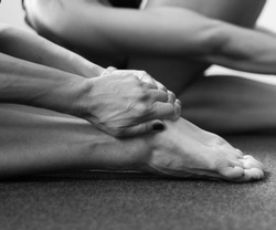 Series of monochromatic black and white photographs taken in a yoga studio. These images explore the yogic grips common in a yoga class.