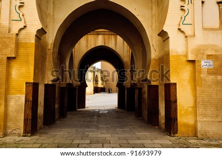 Series of Moorish style curving arches of passageway into mosque courtyard in Fez, Morocco
