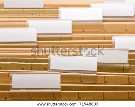 Series of office folders with blank labels