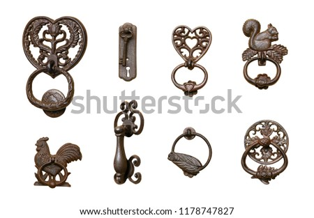 Series of ornate door knockers, isolated on white background. #1178747827