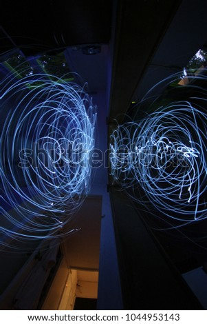 """Series of pictures """"Parallel reality"""".Photo on a long exposure with the light source , the light circle. Photos in style picture light"""