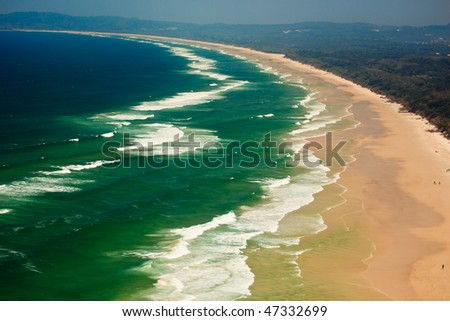 Series of Waves Roll onto Byron Bay Beach in New South Wales, AU
