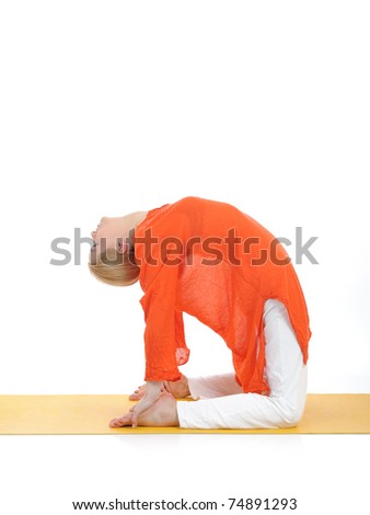 series or yoga photos. young woman in camel pose on yellow pilates mat