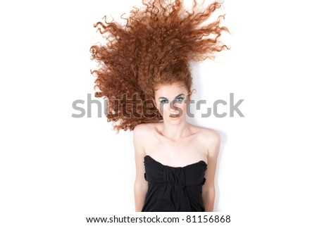 series photo of high angle portrait of the pretty young beautiful woman with long red curly hair lying on floor over white background. Concept of beauty hair care, wellness, style, shampoo, in studio