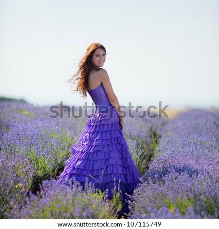 Series. Portrait of beautiful romantic woman in fairy field of lavender